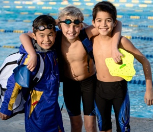 Making friends is one of the benefits of joining a summer swim team.