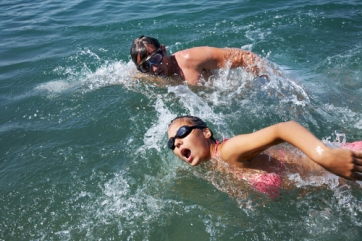 Open water swimmers may need to relieve themselves as they swim.